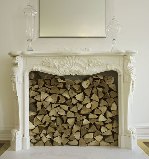 Using An Old Fireplace To Store Fire Wood