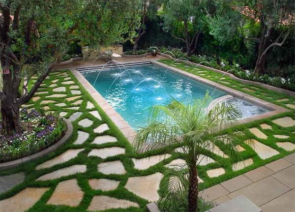 Large Pavers And Grass Around Pool